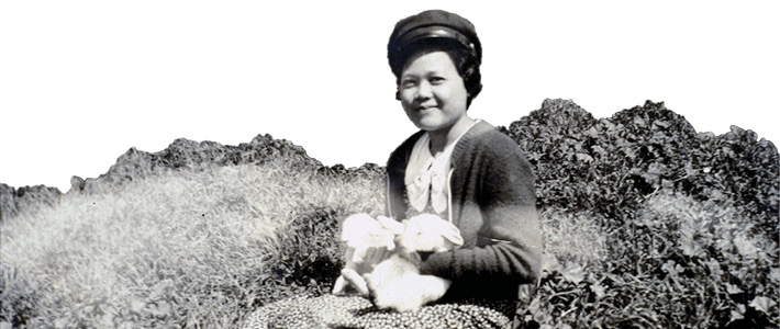 Mary Reyes with rabbits.