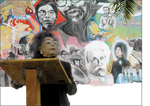 Margie Talaugon in front of Lompoc Filipino American mural