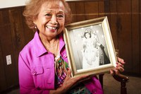Carmen Juanich with Picture of Herself as Queen